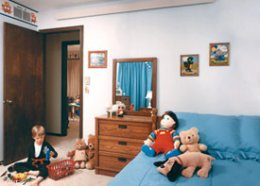 Child sitting in bed room